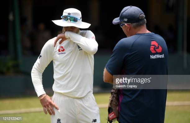 England captain Joe Root speaks with coach Chris Silverwood during the tour match between SLC Board President's XI and England at P Sara Oval on...
