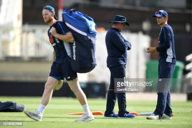 England captain Joe Root speaks with coach Trevor Bayliss as Ben Stokes walks to the nets during a nets session at Trent Bridge on August 17 2018 in...