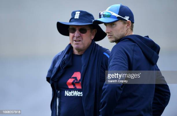 England captain Joe Root speaks with coach Trevor Bayliss during a nets session at Edgbaston on July 31 2018 in Birmingham England