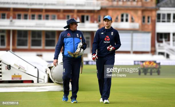 England captain Joe Root speaks with coach Trevor Bayliss during a nets session at Lord's Cricket Ground on September 6 2017 in London England