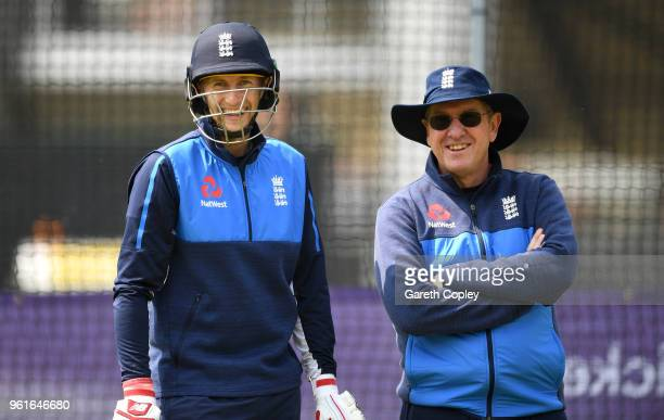 England captain Joe Root speaks with coach Trevor Bayliss during a nets session at Lord's Cricket Ground on May 23 2018 in London England