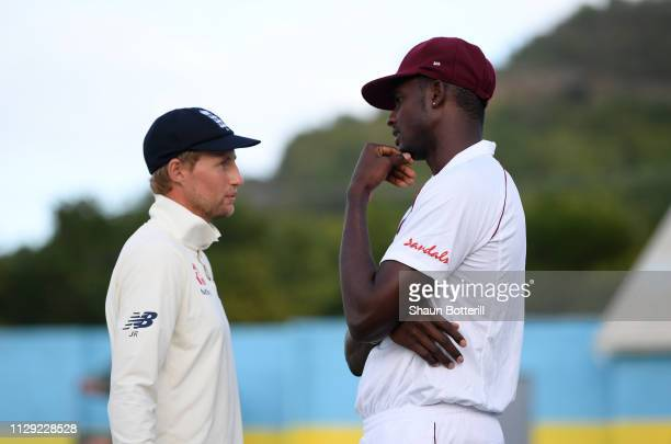 England captain Joe Root talks with West Indies captain Jason Holder at the end of Day Four of the Third Test match between the West Indies and...
