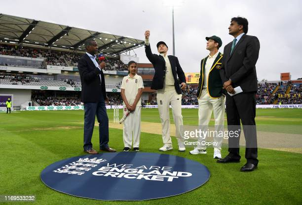 England captain Joe Root tosses the coin alongside Australia captain Tim Paine ahead of day one of the 3rd Specsavers Ashes Test match between...
