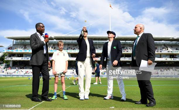 England captain Joe Root tosses the coin alongside Ireland captain William Porterfield ahead of day one of the Specsavers Test Match between England...