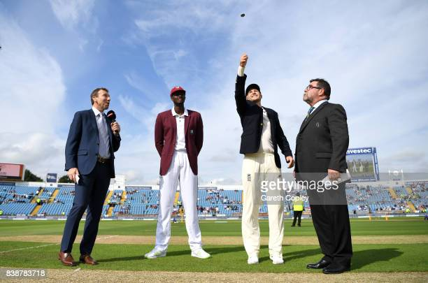 England captain Joe Root tosses the coin alongside West Indies captain Jason Holder ahead of day one of the 2nd Investec Test between England and the...