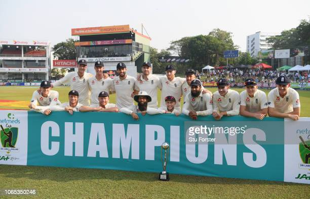 England captain Joe Root with the trophy and team after the win and a 30 series victory during Day Four of the Third Test match between Sri Lanka and...