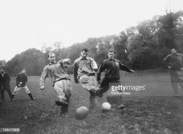 England captain Johnny Haynes and player Bobby Charlton in training at Cheshunt Hertfordshire 24th October 1961 They are preparing for a World Cup...