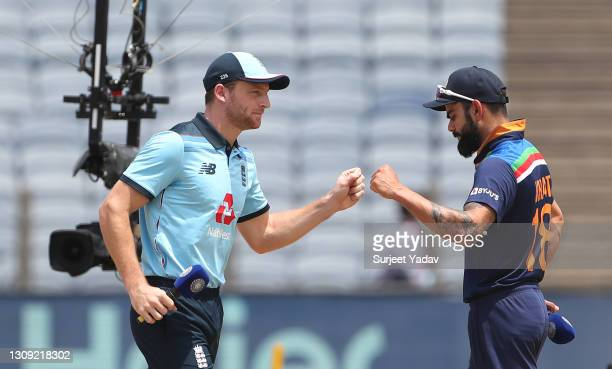 England captain Jos Buttler and India captain Virat Kohli at the toss ahead of the 2nd One Day International between India and England at MCA Stadium...