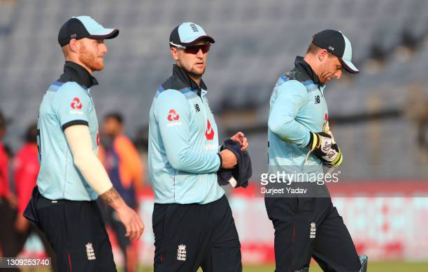 England captain Jos Buttler leaves the field after the India innings with Ben Stokes and Liam Livingstone during the 2nd One Day International...