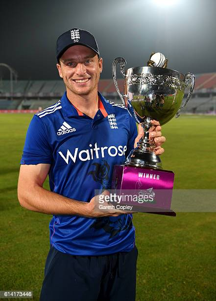 England captain Jos Buttler lifts the series trophy after winning the 3rd One Day International match between Bangladesh and England at Zohur Ahmed...