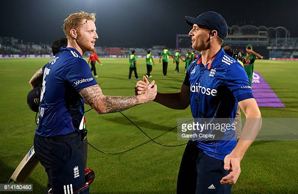 England captain Jos Buttler shakes hands with Ben Stokes after winning the 3rd One Day International match between Bangladesh and England at Zohur...