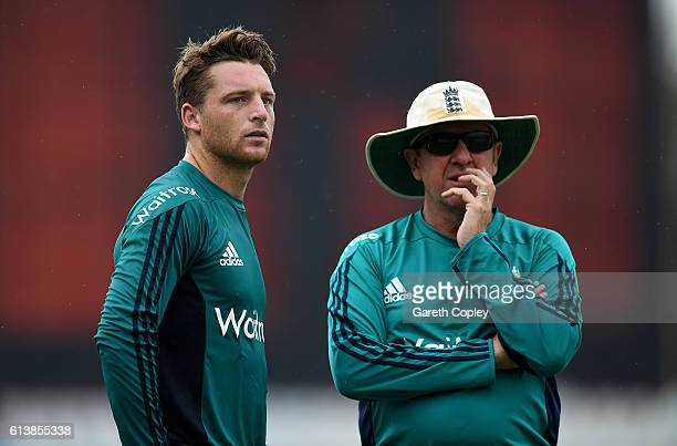 England captain Jos Buttler speaks with coach Trevor Bayliss during a nets session at Zohur Ahmed Chowdhury Stadium on October 11 2016 in Chittagong...