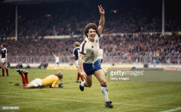 England captain Kevin Keegan celebrates the third goal as Scotland goalkeeper George Wood looks on during a 31 British Championship match at Wembley...