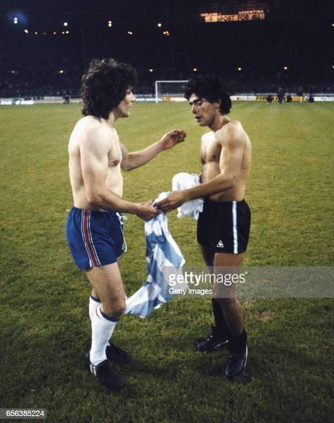 England captain Kevin Keegan exchanges shirts with a teenage Diego Maradona after an International friendly match at Wembley Stadium between England...