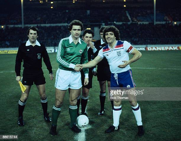 England captain Kevin Keegan meets Northern Ireland's Martin O'Neill watched by the match officials prior to their International friendly at Wembley...