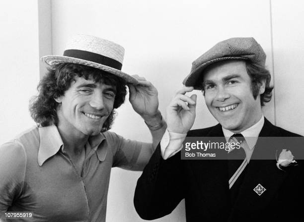 England captain Kevin Keegan with pop star Elton John at Luton airport before the team flew to Copenhagen for the European Championship Qualifying...
