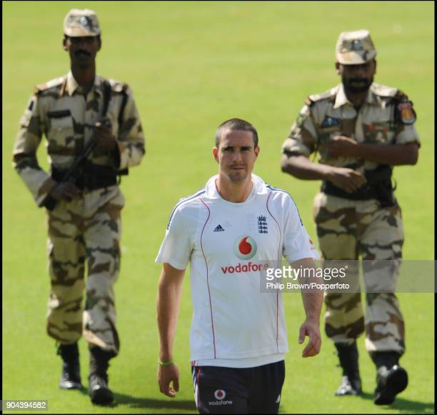 England captain Kevin Pietersen is escorted to a press conference by two soldiers before the 1st Test match between India and England at MA...