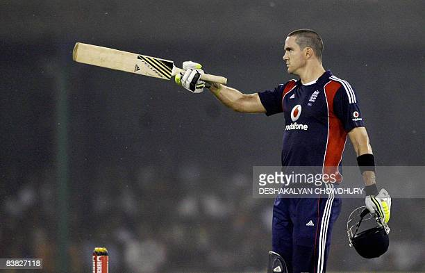 England captain Kevin Pietersen raises his bat in celebration after scoring a century during the fifth One-Day International against India at the...