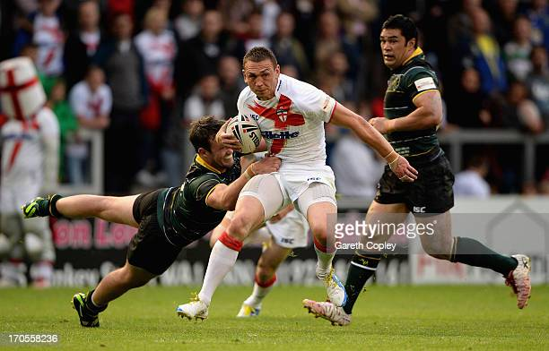 England captain Kevin Sinfield is tackled by Trent Waterhouse of the Exiles during the International Origin Match between England and Exiles at The...