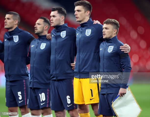 England captain Kieran Trippier sings the national anthem with team mates during the international friendly football match between England and Wales...