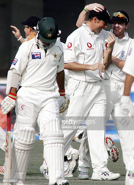 England captain Marcus Trescothick celebrates with a teammate after dismissing off Pakistani batsman Salman Butt during the opening day of first Test...
