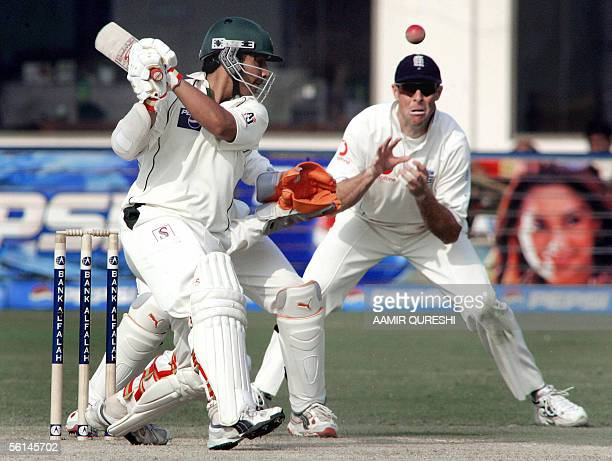 England captain Marcus Trescothick watches the catch off Pakistani batsman Salman Butt during the opening day of first Test match in Multan Cricket...