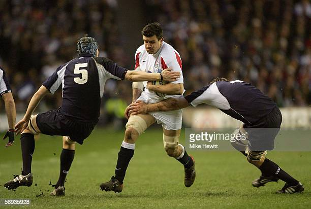 England Captain Martin Corry is tackled by Scott McLeod and Alastair Kellock of Scotland during the RBS Six Nations Championship match between...