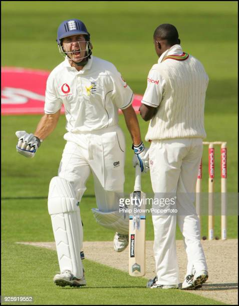 England captain Michael Vaughan celebrates reaching 100 runs after scoring a boundary off West Indies bowler Jerome Taylor during the 2nd Test match...