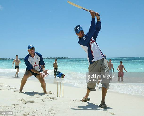 England Captain Michael Vaughan hits out as Matthew Hoggard keeps wicket during a game of beach cricket after winning the third Cable and Wireless...