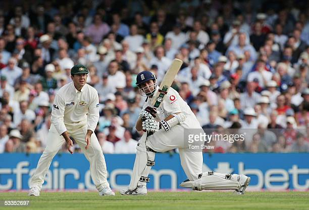 England captain Michael Vaughan hits out watched by Australian captain Ricky Ponting during day one of the Third npower Ashes Test match between...