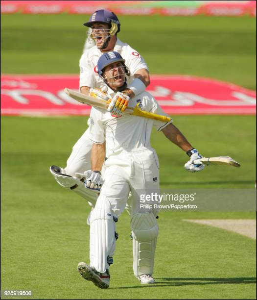 England captain Michael Vaughan is grabbed by teammate Kevin Pietersen as he celebrates reaching 100 runs during the 2nd Test match between England...