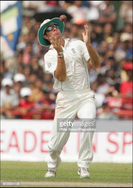 England captain Michael Vaughan juggles but holds a catch from Sri Lanka's Chaminda Vaas during the 3rd Test match between Sri Lanka and England at...