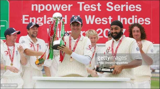 England captain Michael Vaughan lifts the npower trophy and England's man of the series Monty Panesar lifts the Wisden Trophy as England celebrate...