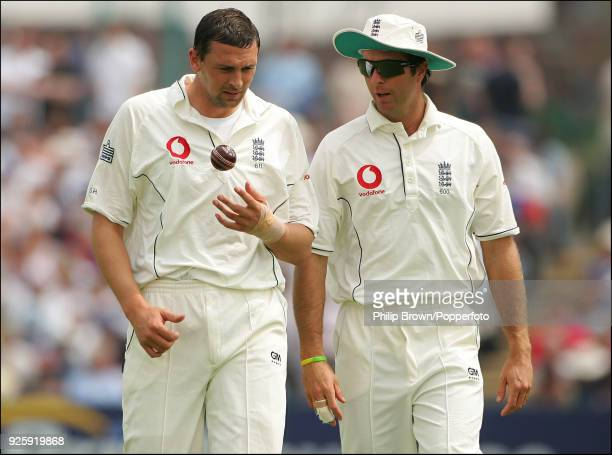 England captain Michael Vaughan talks with teammate Steve Harmison during the 3rd Test match between England and West Indies at Old Trafford...