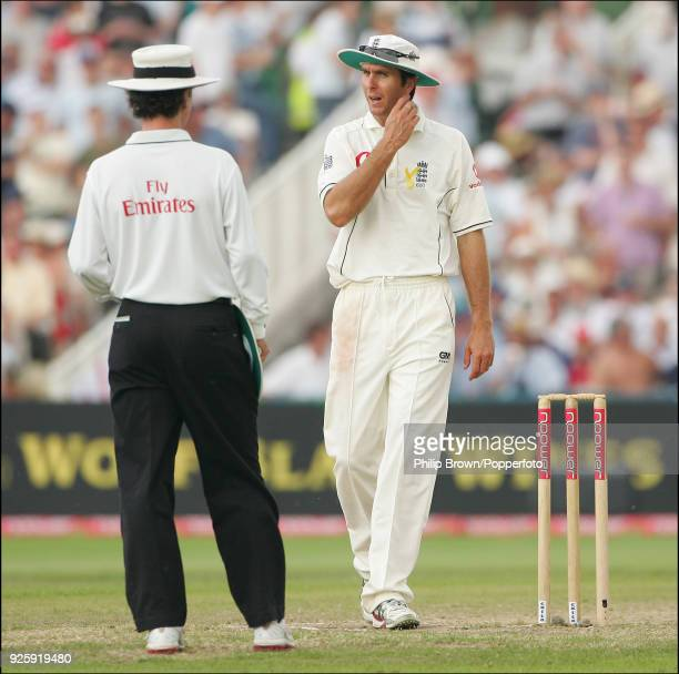England captain Michael Vaughan talks with umpire Billy Bowden after an appeal for a catch off the bat of Dwayne Bravo of West Indies was rejected on...