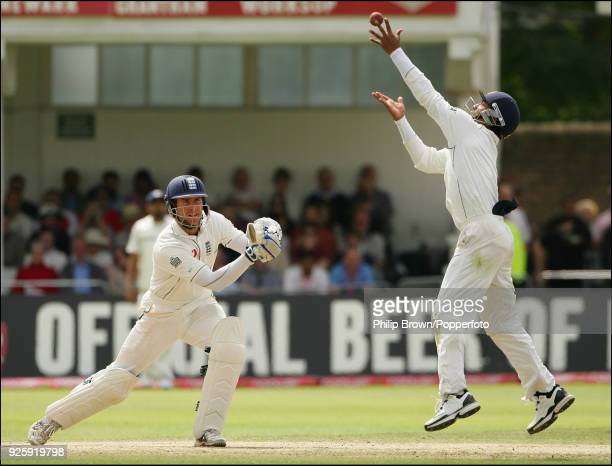 England captain Michael Vaughan watches as Dinesh Karthik of India juggles the ball during the 2nd Test match between England and India at Trent...