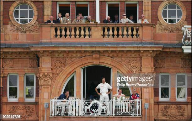 England captain Michael Vaughan watches from the dressing room balcony as the England openers bat during the 1st Test match between England and India...