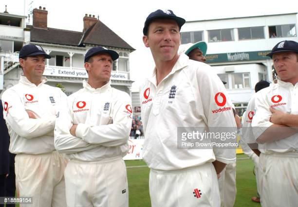 England captain Mike Atherton and other England players watch an interruption to the presentation ceremony after Australia defeated England by 7...
