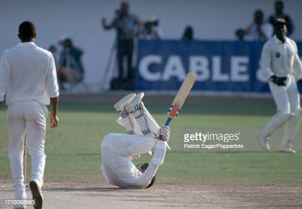 England captain Mike Atherton drops to the ground to avoid a bouncer from West Indies bowler Courtney Walsh during the 1st Test match between West...