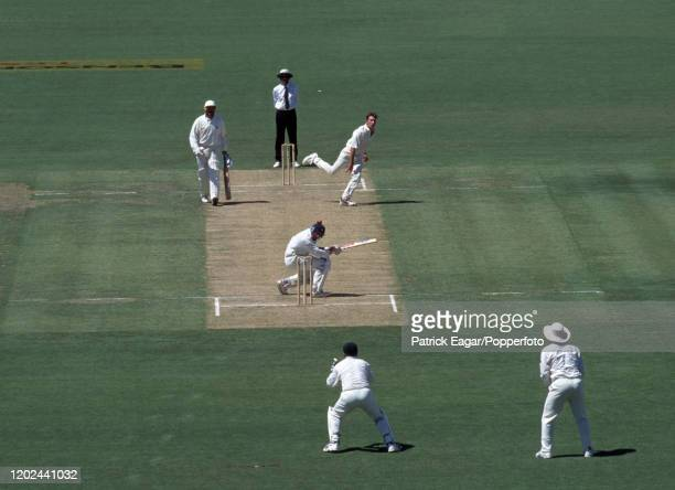 England captain Mike Atherton ducks a bouncer from Damien Fleming of Australia during the 4th Test match between Australia and England at the...