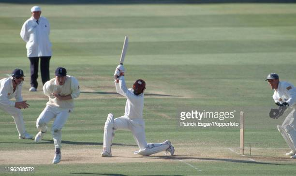 England captain Mike Atherton leaps to avoid a drive from West Indies batsman Brian Lara during the 2nd Test match between England and West Indies at...