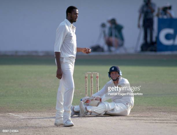 England captain Mike Atherton looks up at West Indies bowler Courtney Walsh after being floored by a bouncer during the 1st Test match between West...