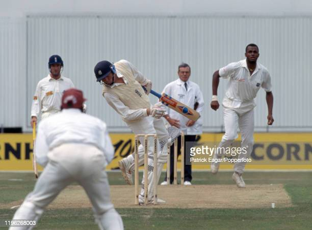 England captain Mike Atherton tries to avoid a bouncer from Courtney Walsh of West Indies during the 4th Test match between England and West Indies...