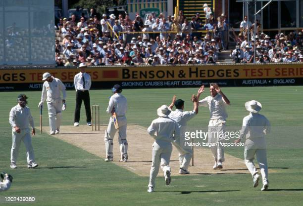 England captain Mike Atherton walks off after being dismissed by Glenn McGrath of Australia caught behind for 4 runs by Australia's wicketkeeper Ian...