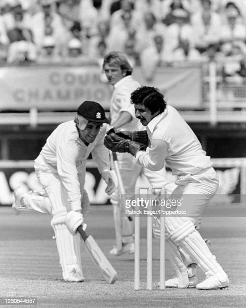 England captain Mike Brearley is about to be run out for 36 runs by Pakistan's wicketkeeper captain Wasim Bari during the 1st Test match between...