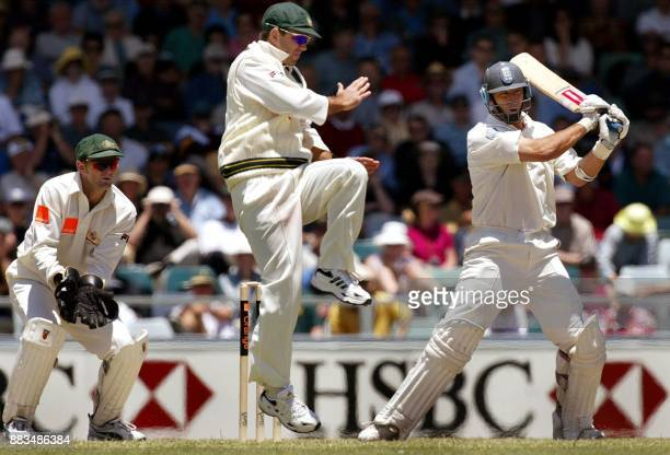England captain Nasser Hussain plays the ball past Australian fieldsman Ricky Ponting watched by wicketkeeper Adam Gilchrist on day three of the...
