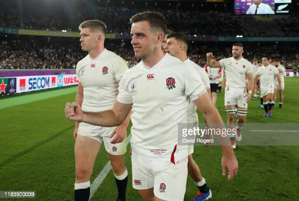 England captain Owen Farrell and George Ford walk around the pitch after their victory during the Rugby World Cup 2019 SemiFinal match between...