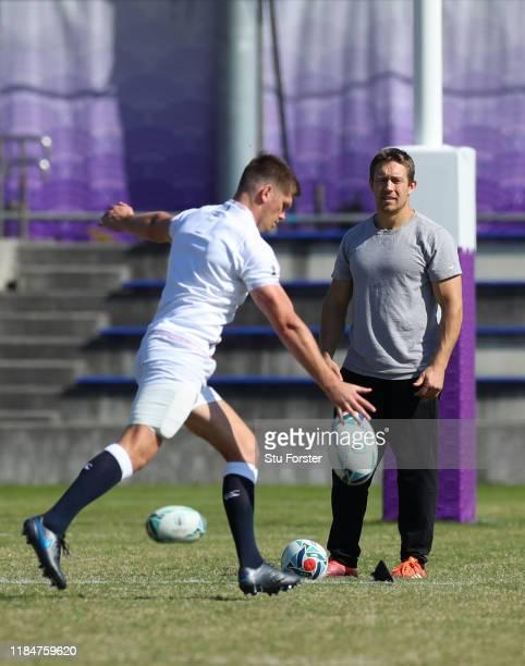 England captain Owen Farrell kicks whilst England 2003 hero Jonny Wilkinson looks on during England captains run ahead of the 2019 Rugby World Cup...