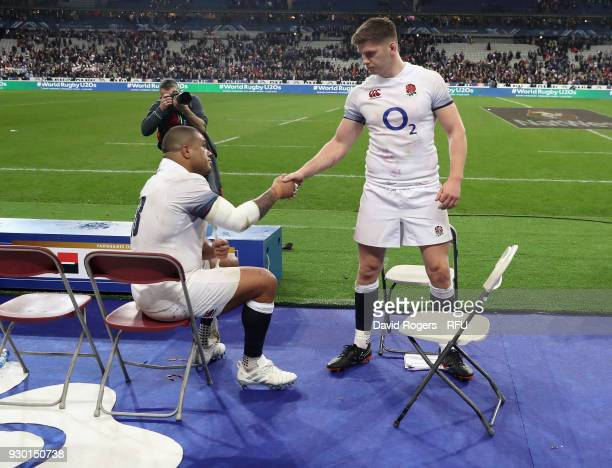 England captain Owen Farrell shakes hands with team mate Kyle Sinckler after their defeat during the NatWest Six Nations match between France and...