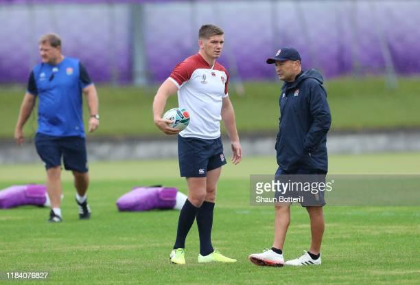 England captain Owen Farrell talks with Head Coach Eddie Jones during a training session at Fuchu Asahi Football Park on October 29, 2019 in Fuchu,...